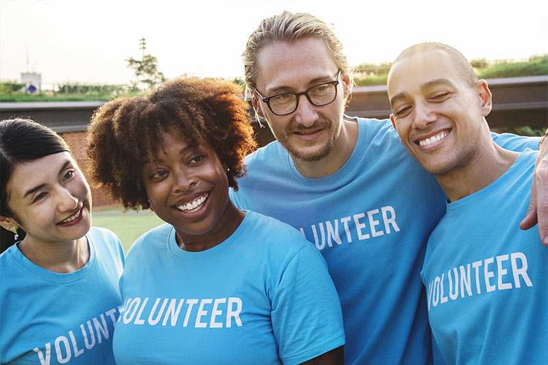 A group of Volunteers Smiling