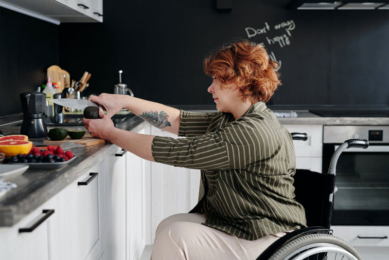 Woman with Disability Cooking in her own kitchen