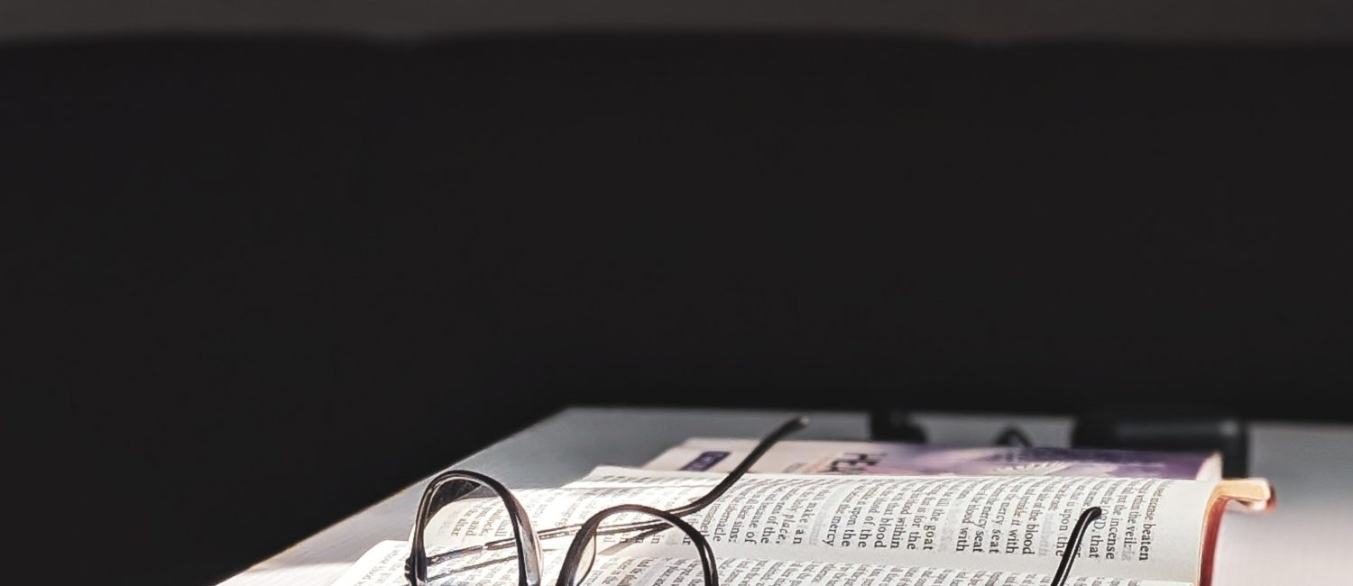 Photo of Eyeglasses on top of a book