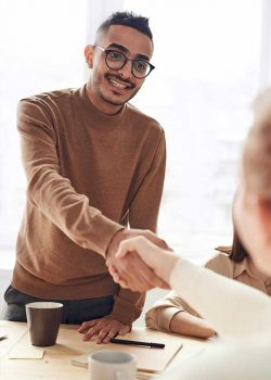 Man shaking hands in a business meeting